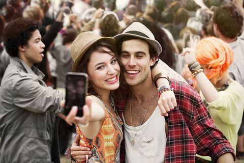 People, Hat, Plaid, Tartan, Crowd, Hand, Fashion accessory, Sun hat, Pattern, Headgear,