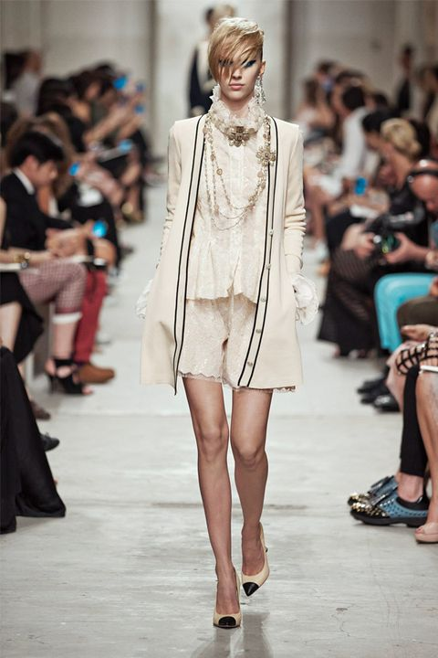 Clothing, Footwear, Leg, Fashion show, Event, Runway, Shoulder, Human leg, Outerwear, Fashion model,