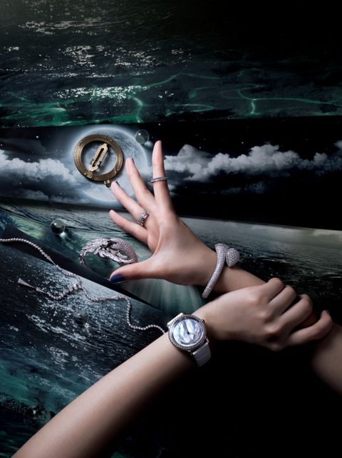Finger, Watch, Wrist, Hand, Fashion accessory, Analog watch, Space, Thumb, Soccer ball, Watch accessory,
