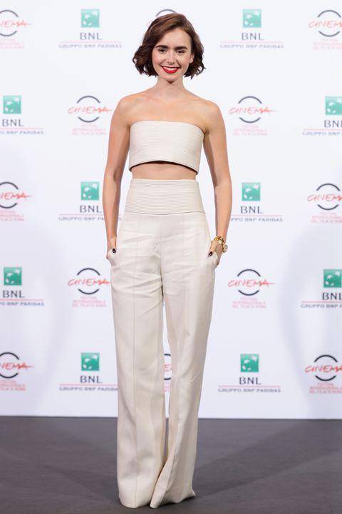 Shoulder, Waist, Style, Logo, Eyelash, Chest, Fashion model, Model, Navel, Stomach,