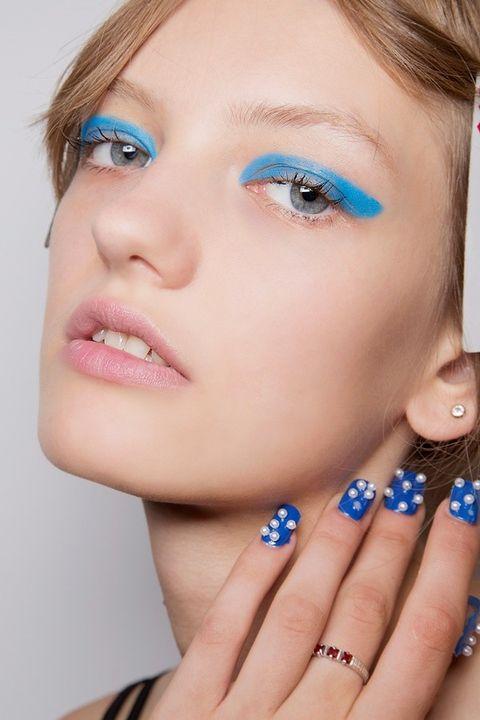 Blue, Finger, Lip, Cheek, Brown, Skin, Hairstyle, Forehead, Eyelash, Eyebrow,