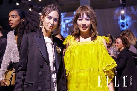 Fashion, Event, Yellow, Fashion design, Fashion model, Performance, Outerwear, Fashion show,