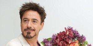 Facial hair, Sleeve, Petal, Bouquet, Flower, Beard, Formal wear, Moustache, Cut flowers, Blazer,