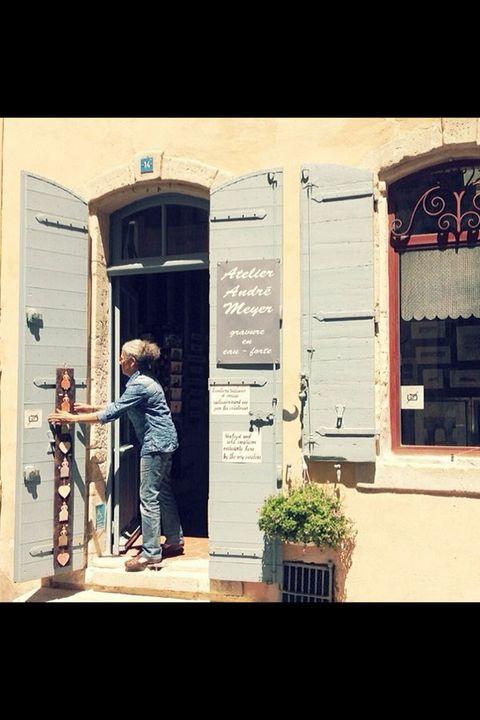 Flowerpot, Jeans, Jacket, Street fashion, Door, Denim, Houseplant, Home door, Stairs,