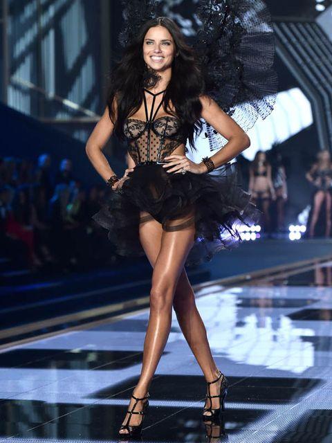 Human, Leg, Hairstyle, Fashion show, Human leg, Human body, Shoulder, Runway, Joint, Dress,