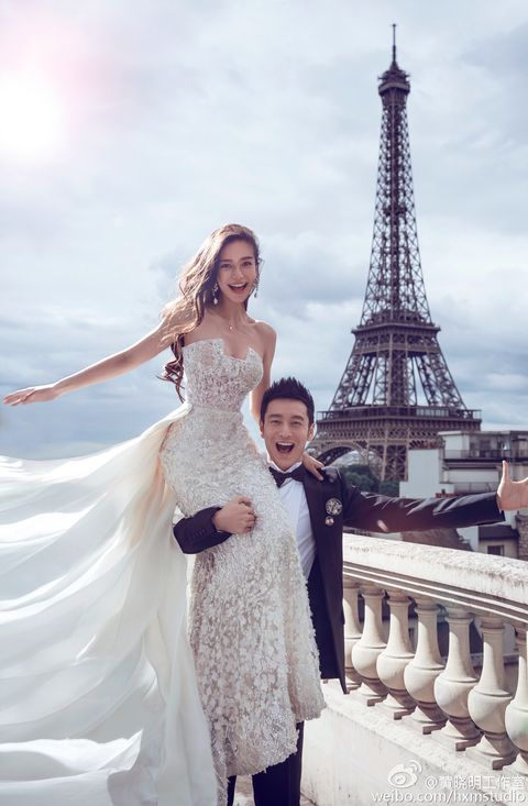 Clothing, Trousers, Tower, Shoulder, Dress, Standing, Photograph, Happy, Bridal clothing, Wedding dress,