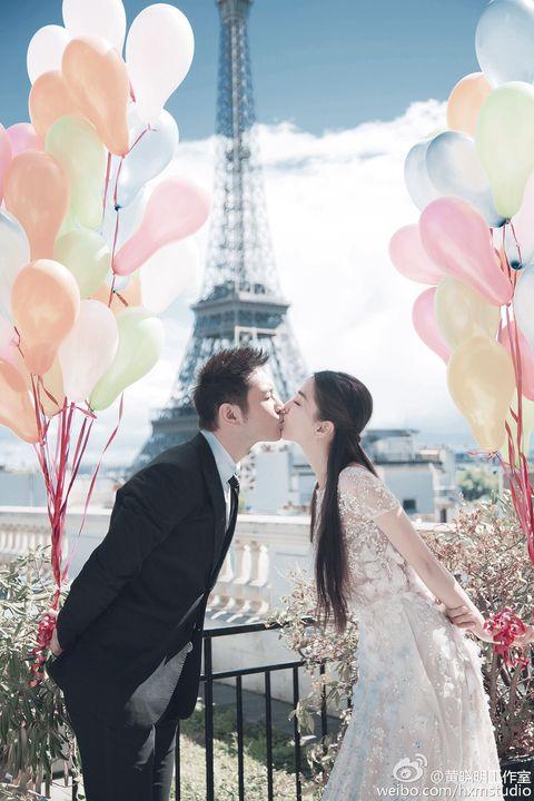 Event, Dress, Balloon, Photograph, Bridal clothing, Petal, Suit, Outerwear, Coat, Bride,