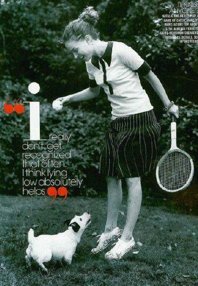 Grass, Sports equipment, Shoe, Dog breed, Mammal, Carnivore, Tennis racket, Dog, Playing sports, Strings,