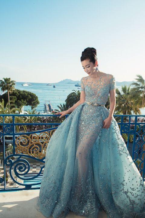 Clothing, Blue, Shoulder, Dress, Textile, Formal wear, Aqua, Teal, Turquoise, Gown,