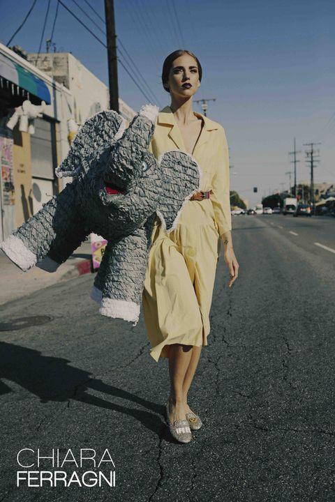 Dress, Asphalt, Street fashion, One-piece garment, High heels, Day dress, Sandal, Vintage clothing, Model, Fashion model,
