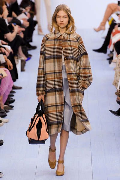 Clothing, Brown, Fashion show, Shoulder, Textile, Joint, Outerwear, Pattern, Runway, Style,