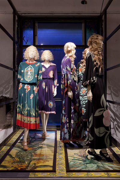 Dress, Fixture, Retail, Mannequin, Carpet, One-piece garment, Display window, Costume design, Boutique, Fashion design,
