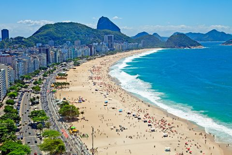 Body of water, Coastal and oceanic landforms, Coast, Shore, Tourism, Water, Sand, Beach, Ocean, People on beach,