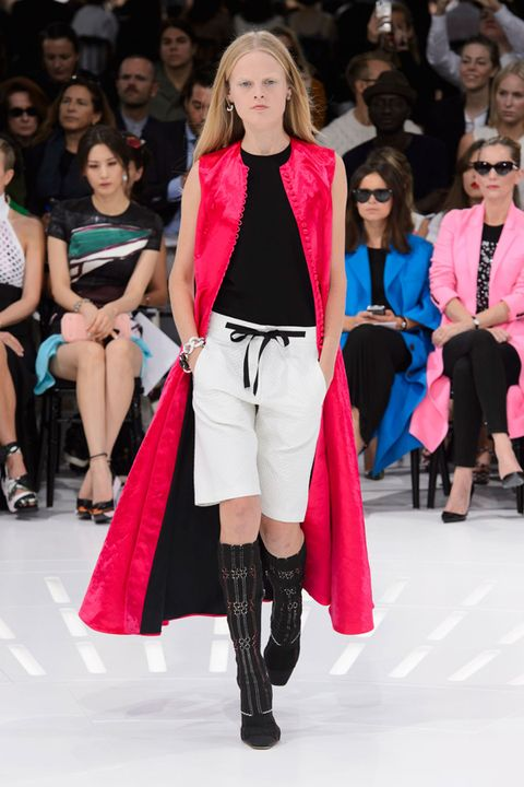 Clothing, Footwear, Face, Leg, Event, Trousers, Outerwear, Dress, Coat, Style,