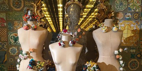 Mannequin, Temple, Retail, Necklace, Display window, Fashion design, Collection, Tradition, Day dress, Floral design,