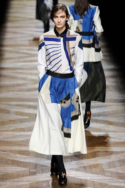 Costume design, Uniform, Costume, Fashion, Electric blue, Cobalt blue, Fashion design, High heels, Acting, Boot,