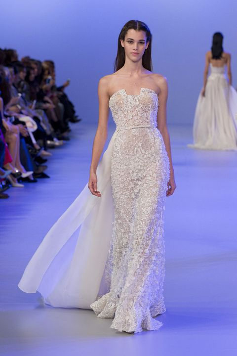 Clothing, Fashion show, Hairstyle, Human body, Shoulder, Dress, Joint, Runway, Gown, Formal wear,