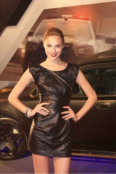 Dress, Cocktail dress, Little black dress, Vehicle door, Thigh, Satin, One-piece garment, Day dress, Latex, Waist,