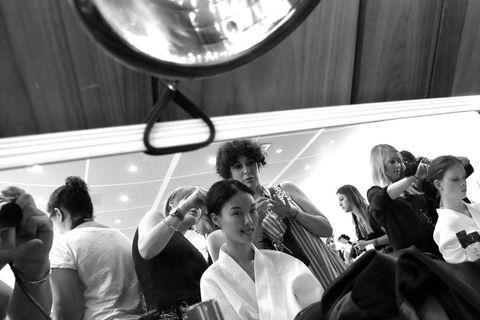 Hair, Arm, Glass, Sitting, Interaction, Crowd, Passenger, Public transport, Conversation, Mirror,