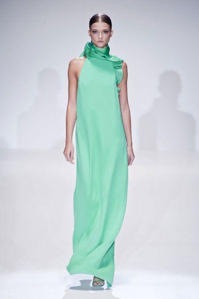 Sleeve, Green, Shoulder, Dress, Standing, Joint, Formal wear, Style, One-piece garment, Fashion model,