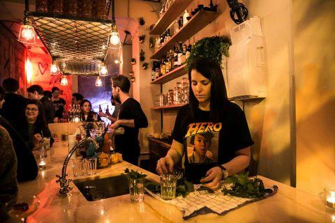 Lighting, Barware, T-shirt, Glass, Customer, Countertop, Restaurant, Houseplant, Bar, Shelf,