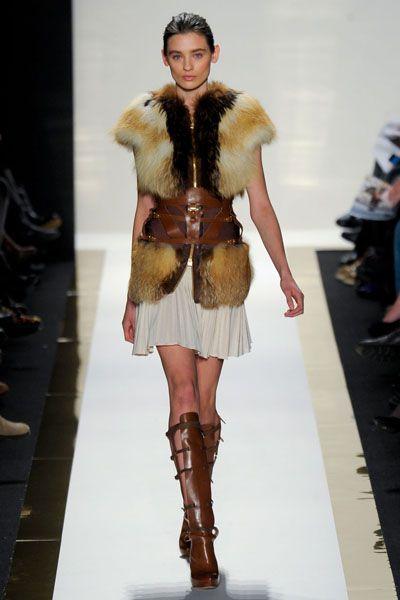 Leg, Fashion show, Shoulder, Textile, Joint, Outerwear, Runway, Human leg, Fashion model, Fur clothing,