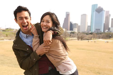 Smile, Sleeve, Jacket, Outerwear, Happy, Facial expression, People in nature, Tower block, Interaction, Honeymoon,