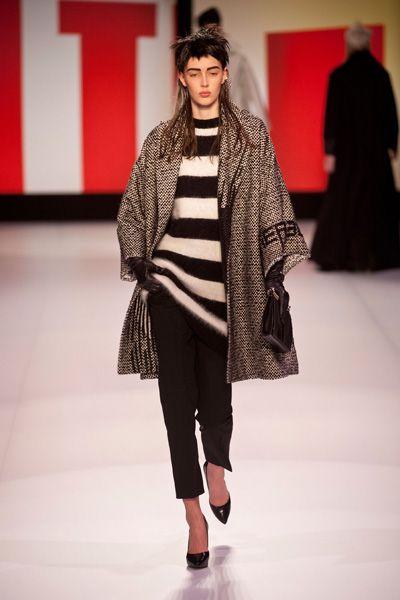 Clothing, Fashion show, Shoulder, Winter, Textile, Runway, Outerwear, Fashion model, Style, Street fashion,