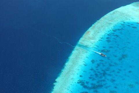 Blue, Atmosphere, Aircraft, Aqua, Azure, Flight, Turquoise, Aerobatics, Air travel, Aviation,