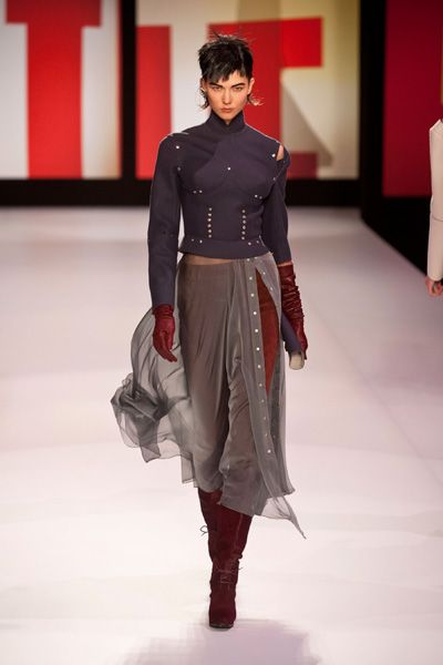 Leg, Fashion show, Sleeve, Runway, Textile, Red, Joint, Style, Fashion model, Waist,