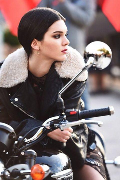 Nose, Mammal, Motorcycle, Jacket, Street fashion, Motorcycling, Long hair, Leather, Leather jacket, Eye liner,