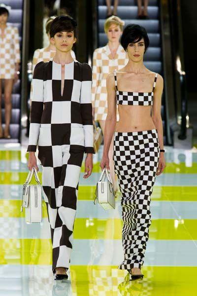 Clothing, Leg, Fashion show, Yellow, Shoulder, Pattern, Runway, Fashion model, Style, Waist,