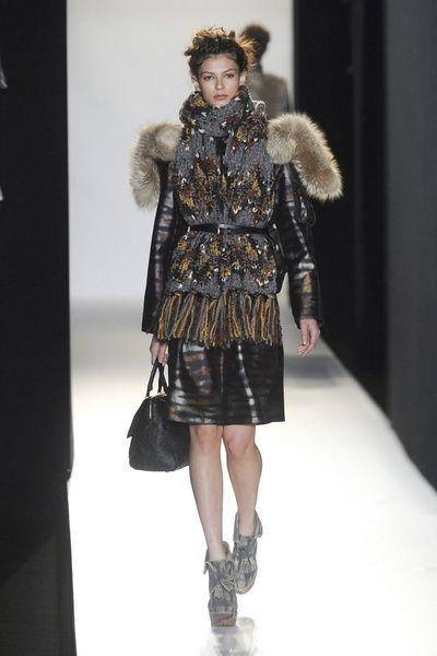 Clothing, Leg, Fashion show, Shoulder, Textile, Winter, Human leg, Runway, Outerwear, Fashion model,
