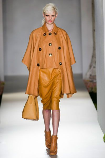 Brown, Sleeve, Human body, Fashion show, Textile, Joint, Outerwear, Style, Fashion model, Runway,