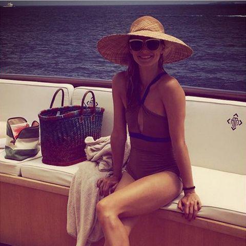 Clothing, Eyewear, Hat, Sunglasses, Summer, Sun hat, Bag, Sitting, Fashion accessory, Beauty,