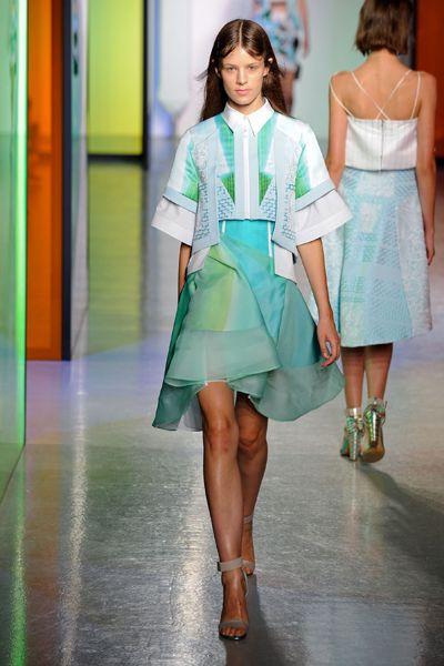 Clothing, Green, Shoulder, Fashion show, Human leg, Joint, Style, Runway, Fashion model, Waist,