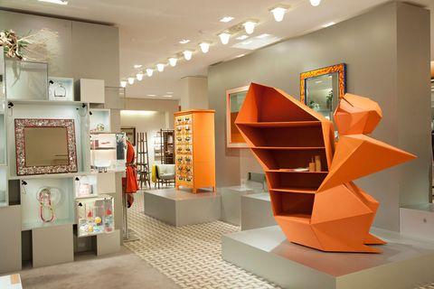 Lighting, Interior design, Ceiling, Interior design, Orange, Collection, Light fixture, Shelf, Exhibition, Plywood,