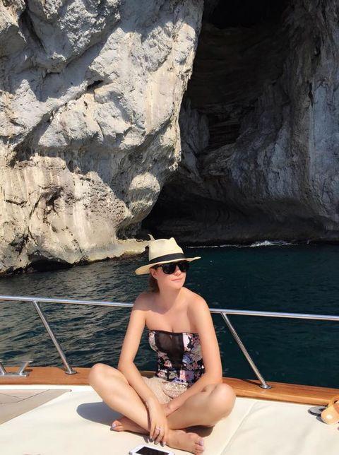 Hat, Coastal and oceanic landforms, Watercraft, Boat, Vacation, Sun hat, Formation, Sea, Sunglasses, Bedrock,