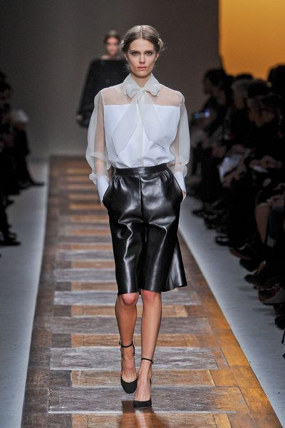 Clothing, Footwear, Fashion show, Shoulder, Joint, Outerwear, Runway, Fashion model, Style, Fashion,