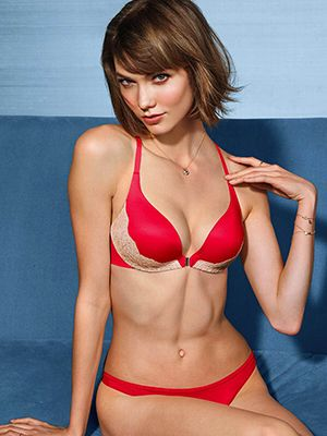 Clothing, Hair, Hairstyle, Skin, Brassiere, Bikini, Joint, Chest, Undergarment, Swimsuit top,