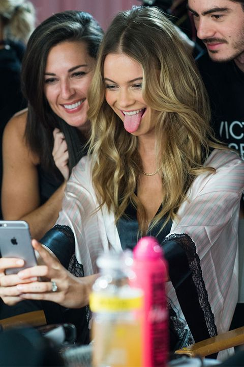 Hair, Face, Head, Nose, Mouth, Smile, Hairstyle, Mobile phone, Facial expression, Portable communications device,