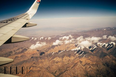 Airplane, Sky, Aircraft, Air travel, Aviation, Atmosphere, Mountainous landforms, Airliner, Landscape, Mountain range,
