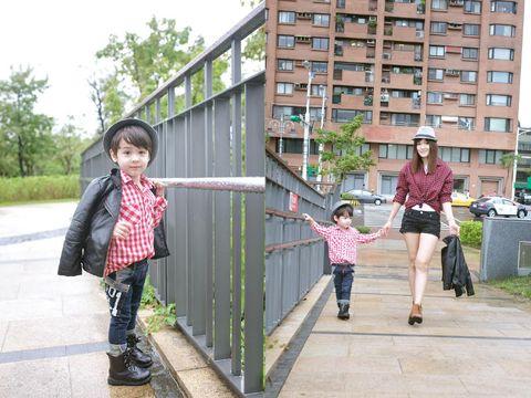 Clothing, Leg, Trousers, Building, Child, Jacket, Shorts, Condominium, Street fashion, Pedestrian,
