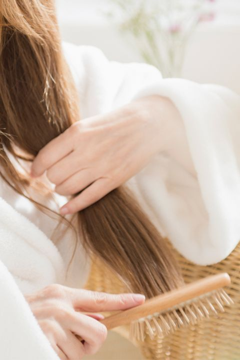 Finger, Hairstyle, Skin, Hand, Wrist, Nail, Long hair, People in nature, Beauty, Brown hair,
