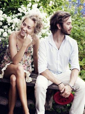 Clothing, Leg, Sitting, Photograph, People in nature, Petal, Dress, Thigh, Shrub, Spring,