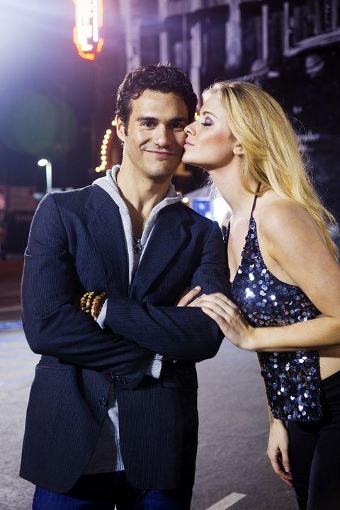 Interaction, Love, Electric blue, Romance, Blond, Light fixture, Hug, Honeymoon, Tights, Pocket,
