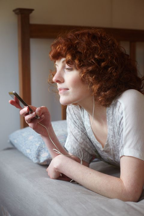 Finger, Hairstyle, Hand, Mobile phone, Beauty, Red hair, Brown hair, Portable communications device, Nail, Long hair,