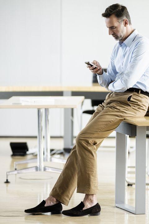 Leg, Shoe, Dress shirt, Shirt, Sitting, Standing, Elbow, Suit trousers, Knee, Khaki,