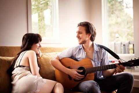 Musical instrument, Guitarist, String instrument, Comfort, Guitar, Acoustic guitar, Plucked string instruments, Musician, String instrument, Sitting,