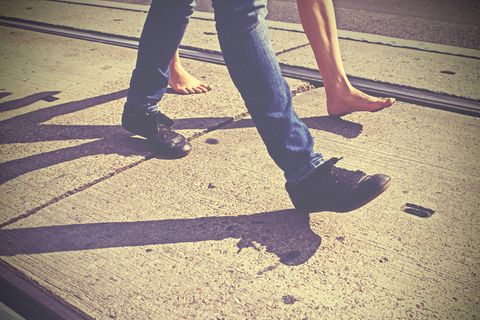 Leg, Shoe, Human leg, Road surface, Shadow, Street fashion, Calf, Tints and shades, Foot, Walking,